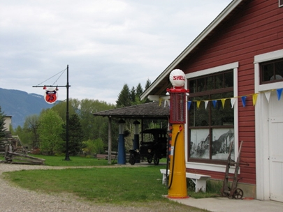 Car and pumps on the village street.JPG