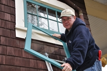 Ted McTaggart installing the storm windows.jpg